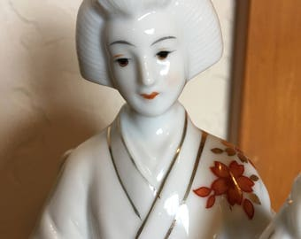 Porcelain rotating Geisha music box playing a Shamisen made in Japan