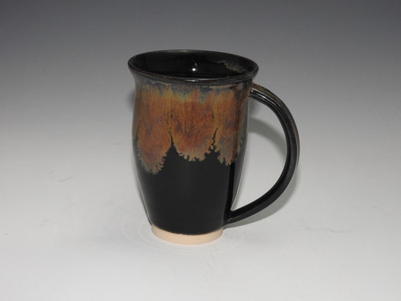 Beautiful earth tones hand made mug with rich brown, copper and gold highlights over black