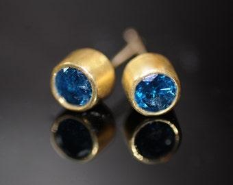 Blue diamond studs in high karat gold, tcw one carat, sparkling blue diamond earrings in rich gold bezels, modern and classic earrings