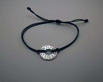 Bracelet engraved by hand and silvered