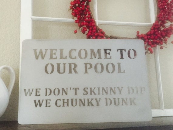 Welcome to our Pool We don't skinny dip we chunky dunk  metal sign