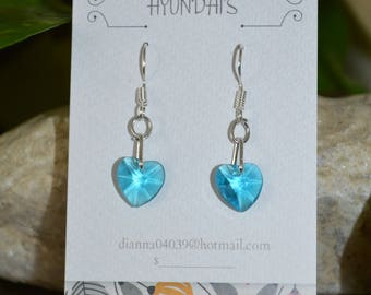 These earring's are a sky blue glass heart,with a extra loop on a silver plated earring hook!