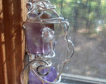 Purple Amethyst silver plated wire wrapped pendant.