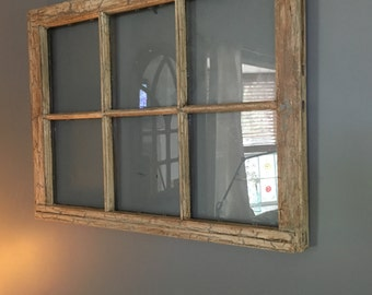 Antiqe window with distressed finish