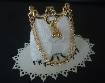 Elegant lace bridal purse 1/12th scale.