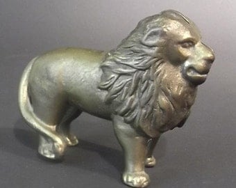 Antique Cast Brass Bank in the Shape of a Lion