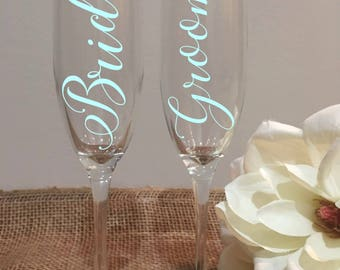 Bride & Groom Toasting Glasses/Wedding Glasses/Wedding champagne flutes/Bride and Groom Champagne/Etched Lettering/Vinyl Lettering/Set of 2