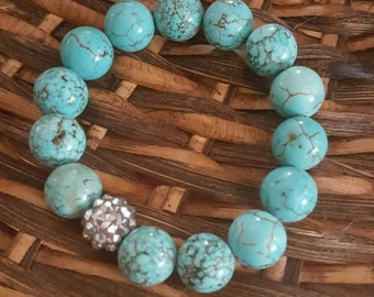 Turquoise howlite bead bracelet with blingy bead 12mm