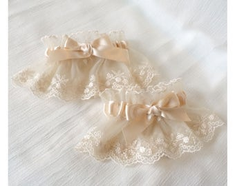Cream elegant tulle lace wrist cuffs with satin bows