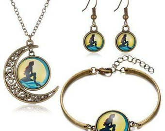 The little mermaid disney necklace earring bracelet set.