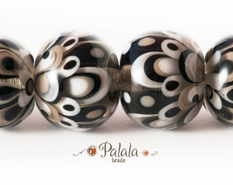 Set of monochrome lampwork beads