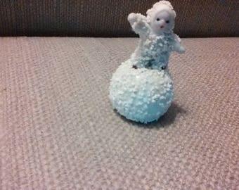 Tiny antique snowbaby
