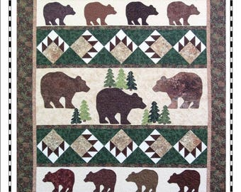 Quilt Pattern with Bear Paw Blocks and appliqued Bears + Trees.