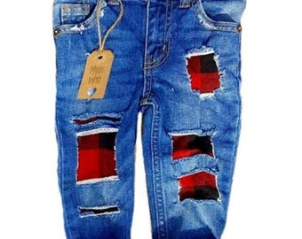"""The """"Little Stitches buffalo plaid patch skinnies"""" hand distressed jeans for infant and toddlers. Ripped baby and toddler jeans."""