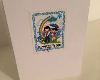 Rainbow love postage stamp greeting card from Mongolia, blank inside