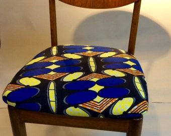 Vintage chair upholstered with wax print