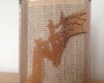 Giraffe cut & fold book art