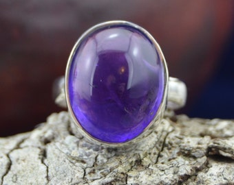 Round amethyst stone set in a Sterling Silver band sizes 7 and 7.25