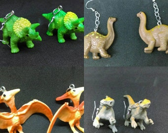 Dinosaur earrings inspired by miss frizzle. (Can be accommodated to fit tunnels in stretched ears.)