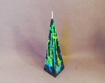 Black pyramid candle with fluorescent drips