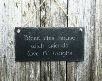 Slate plaque featuring a traditional irish welcome quote.  Hand made to order using traditional sandblasting methods.