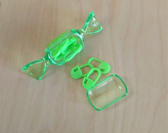 Stitch markers in candy case - green hard plastic sweets case with neon green plastic lockable stitch markers