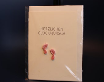Lovely greeting card in beighe with light pink paper footprints