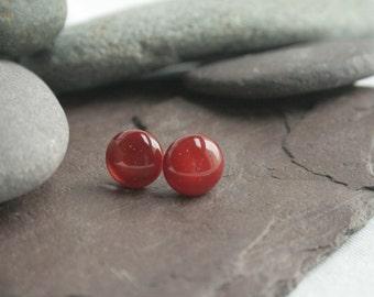 Dark red glass stud earrings.