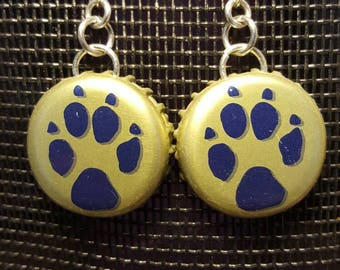 Bottle cap earing with paw print