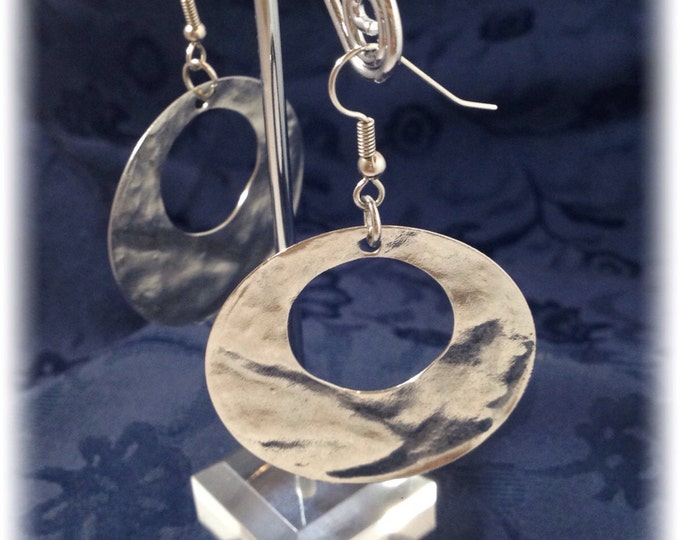 Silver round earrings. Hammered steel. Dangling.