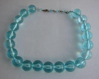 1950's, transparent turquoise plexi shokermade. Rare.