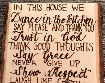 In this house we dance in the kitchen sign