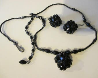 "A vtg.black beaded necklace and earring set  signed l/c --1/2"" cluster earrings with c/b--18"" end to end necklace"