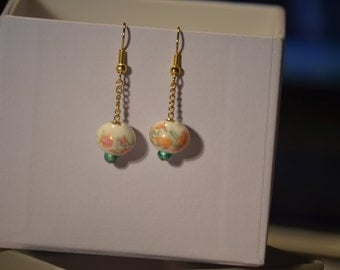 White, pink, and gold porcelain bead earings