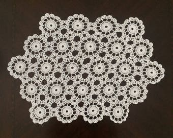 Hexagonal doily handmade with 100% cotton yarn. An eye catching and unique doily/runner that will look good in any home