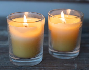 Beeswax votive candles in clear glass holders