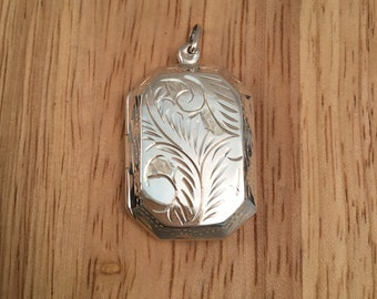 Classic Sterling silver keepsake locket with etched detail to front and back