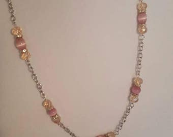 Pearly pink bead necklace with silver chain