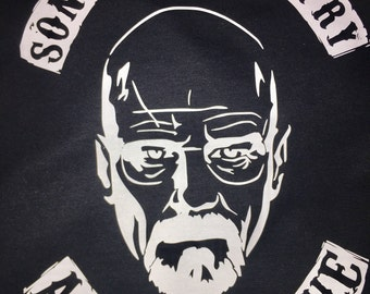 "Breaking Bad and Sons of Anarchy Combo T-Shirt. Combines the two shows, saying ""Sons of Chemistry"" with Walt's Face centered"