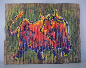 Red Bull colorfull painting carved wood. Wall Art decoration made with recycled wood.