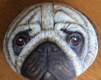 Hand painted with acrylics, a pug dog on a small pebble