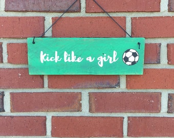 Kick like a girl soccer sign