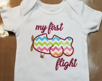 My first flight/baby travel onesie - girl