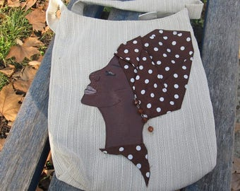 Beige shoulder bag made of upholstery fabric and VEGAN leather! Cream colored crossbody bag with an African woman detail!