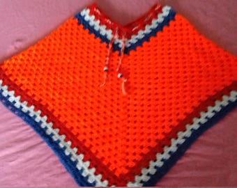 Orange crochet children's poncho