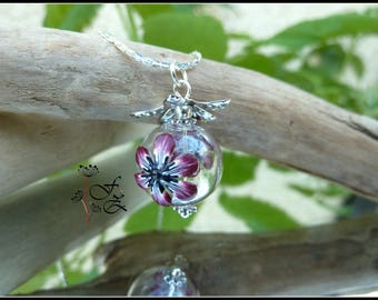 silver plated necklace with a flowered glass - polymer clay pendant