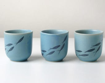 Hand-thrown egg cups with fish