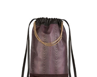 Leather drawstring backpack with optical illusion textile design