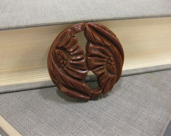 Carved Chocolate-Colored Bakelite Brooch