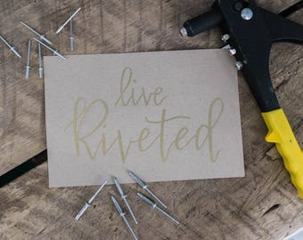 Live Riveted Airstream Gold foil hand writing on brown  card stock